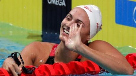 Canada's Kylie Masse wins world title, sets world record