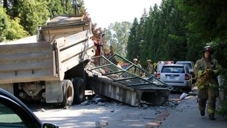 dump truck hits overpass