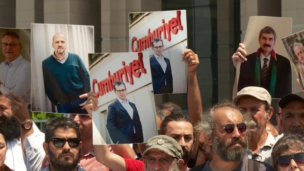 Supporters of the Cumhuriyet newspaper staff on trial in Istanbul gather daily at the Caglayan courthouse.