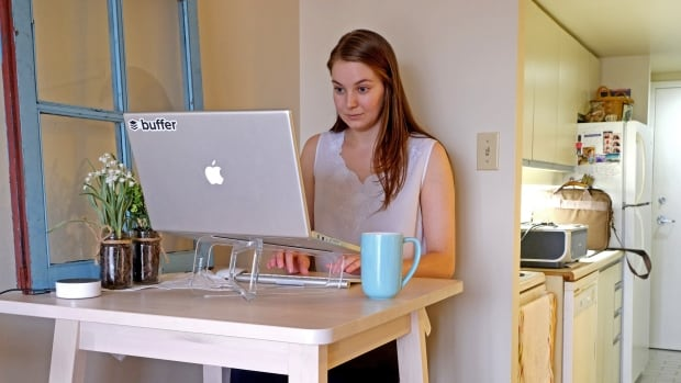 Hailley Griffis works for Buffer, a social media company with no physical office, from a bachelor apartment in Toronto.