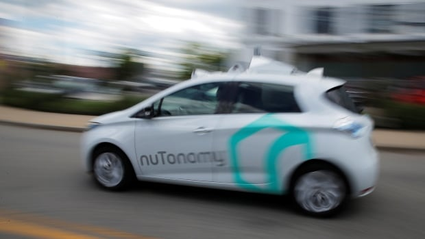 A self-driving car being developed by nuTonomy, a company creating software for autonomous vehicles, is guided down a street near their offices in Boston in this June 2017 photo.