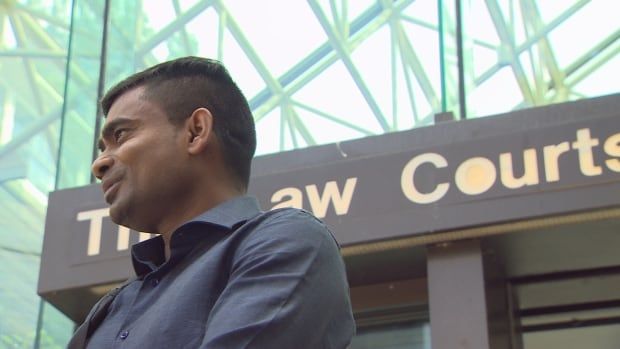 Jeyachandran Kanagarajah standing outside of B.C. Supreme Court in Vancouver. He is one of four men who was acquitted Thursday on charges of human smuggling