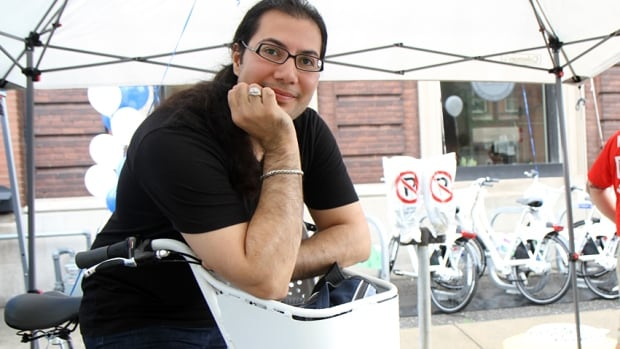 Firas Al Kurdi arrived in Hamilton from Syria in December 2015. He uses a SoBi bicycle to get everywhere. The company is making a concerted effort to sign up newcomers, and offers them $3 memberships if they take a safety training session.