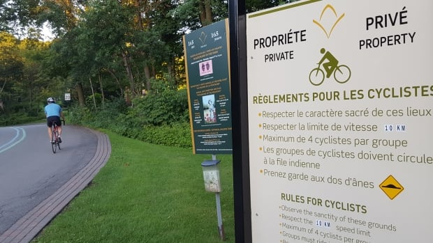 Mount Royal Cemetery's executive director says he wants to keep the grounds open and available to everyone but an influx of cyclists threatens that.