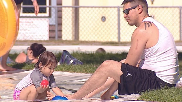 A family beats the heat at the water park in Eau Claire in Calgary this week.