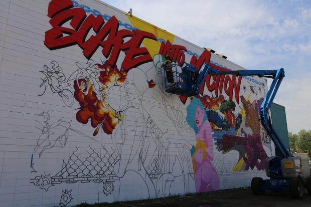 New York Based Graffiti Artist MAST Works On A Giant Action Themed Mural On  The Wall Of Downtown Edmonton Night Club. (Sam Martin/CBC) Part 61