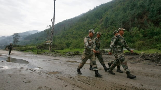 Indian army soldiers march near an army base on India's Tezpur-Tawang highway, which runs to the Chinese border, in the northeastern Indian state of Arunachal Pradesh on May 29, 2012.
