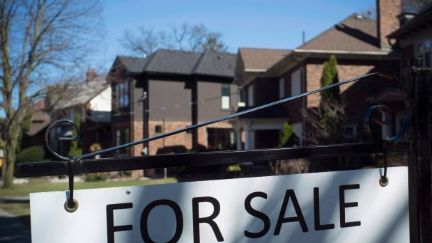 A west-end Toronto street bears a house For Sale sign in April. Although home sales have dropped recently, the fees associated with buying and selling houses make up almost two per cent of Canada's gross domestic product.