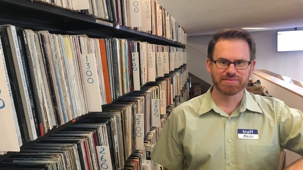 Librarian Beau Levitt spent a lot time researching which albums to add to the library's record collection.