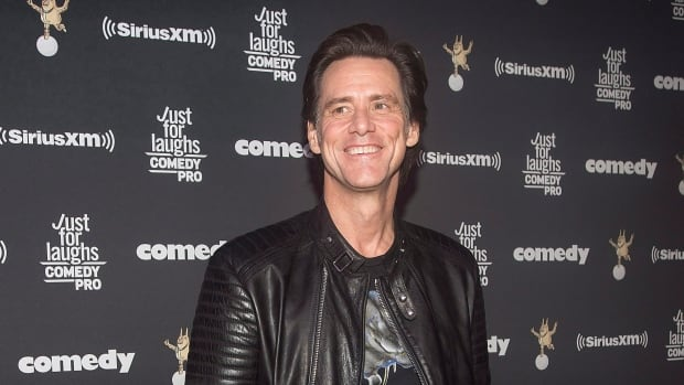 Actor Jim Carrey poses as he arrives for the Just for Laughs awards show at the annual comedy festival in Montreal Friday.