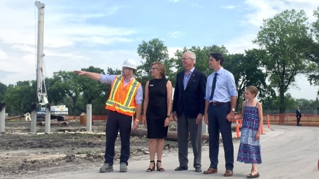 Prime Minister Justin Trudeau (second from right) and his daughter Ella-Grace get a tour of the future site of Canada's Diversity Gardens at Assiniboine Park.