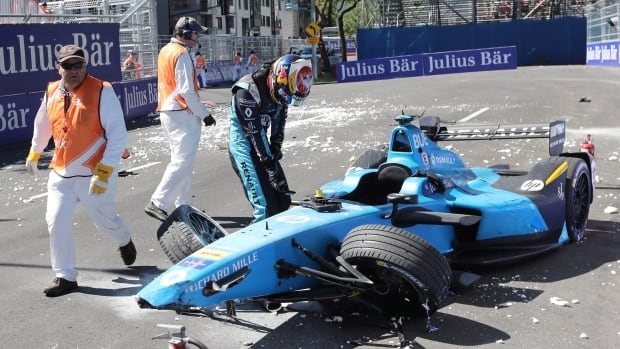 Sébastien Buemi, of Switzerland, checks the damage to his car after crashing during the second practice session at the Montreal Formula E race. Radio-Canada has learned the non-profit set up to organize the event owes Formula E millions of dollars.