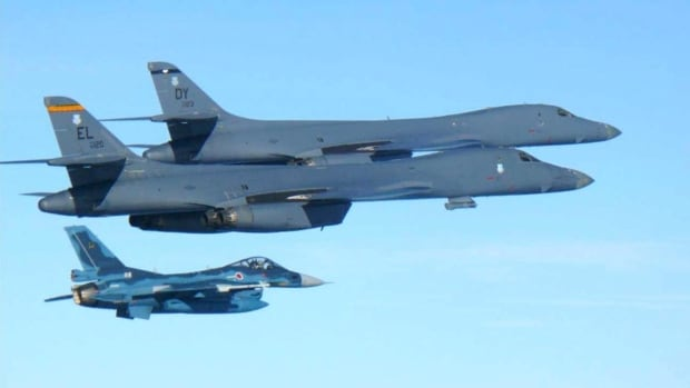U.S. Air Force B-1B bombers, top, fly with a Japan Air Self Defence Force F-2 fighter jet over Japan's southern island of Kyushu, just south of the Korean Peninsula, during a joint exercise on Sunday.