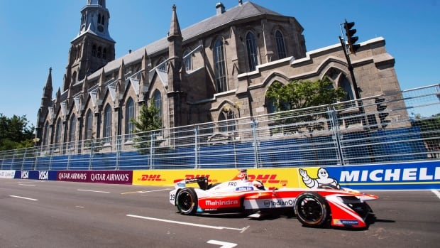 Felix Rosenqvist of Sweden, heads toward the finish line on his way to winning the pole position for the Montreal Formula ePrix electric car race Sunday, July 30. The races have gone smoothly but area residents say the race has caused significant disruptions.