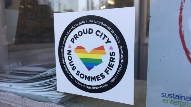 An example of a Proud City window sticker, which lets spaces in the Ottawa area that are welcoming and inclusive to the LGBTQ community showcase it. The campaign is launching in the days before Pride month in the capital.