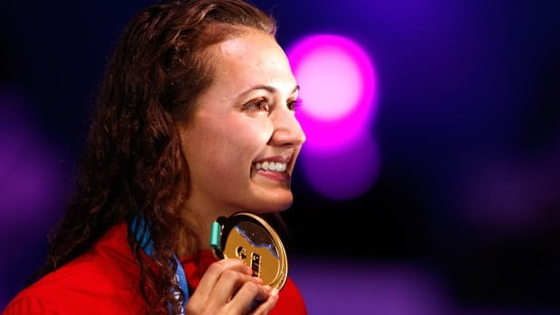 Gold medallist Kylie Masse poses with the medal won during the women's 100m backstroke final in Budapest, Hungary. It marked Canada's lone world title of the event.