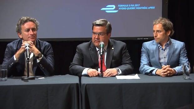 Formula E founder Alejandro Agag, left, Montreal Mayor Denis Coderre, centre, and Simon Pillarella - the head of Montréal, c'est électrique! - speak at a news conference after the Formula E race in Montreal.