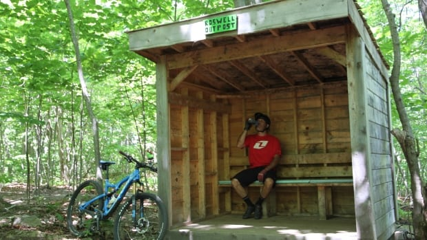 Mountain biker Laurie Robichaud takes a break in a shelter recently built by Saint John Cycling.