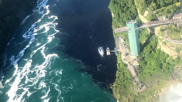The water near the base of the falls that border the U.S. and Canada turned an alarming shade of black before tourists' eyes following a foul-smelling discharge from a wastewater treatment plant.