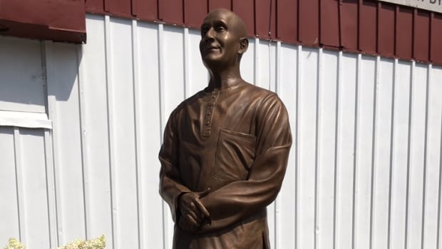 A statue of a controversial Indian spiritual leader, Sri Chinmoy, was erected outside a dry cleaners in Old Ottawa South, Sunday, July 30, 2017.