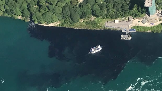 The Maid of Mist is shown travelling through black wastewater treatment discharge in the Niagara River near the American side on July 29.