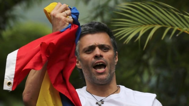 Venezuelan opposition leader Leopoldo Lopez greets supporters outside his home in Caracas earlier this month following his release from prison. Government officials removed him from his home, where he was under house arrest.