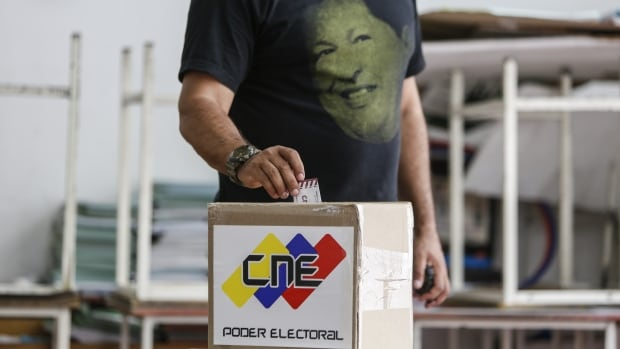 A Venezuelan with a T-shirt bearing the image of late leader Hugo Chavez votes in Caracas on July 30 in the elections of the National Constituent Assembly. Smartmatic, which has consulted for Venezuela, said turnout results were overstated.