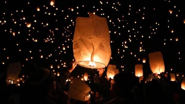 During The Lights Fest festivalgoers ignite their sky lanterns and let them take flight.
