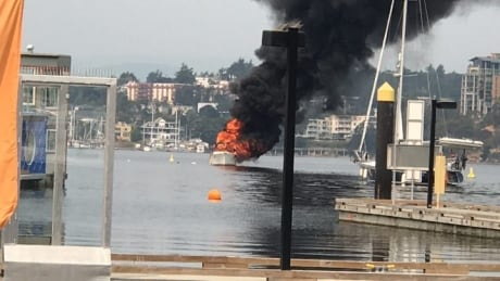 Burning boat in Victoria Harbour Aug 2 2017