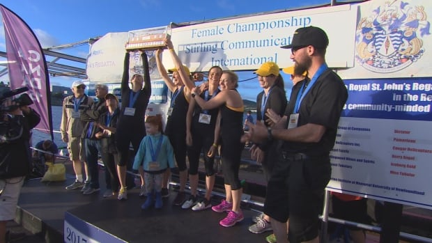 The M5 crew hoists the regatta trophy Aug. 2, after once again becoming the women's champions.