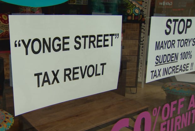 Image result for toronto yonge street shop signs taxes