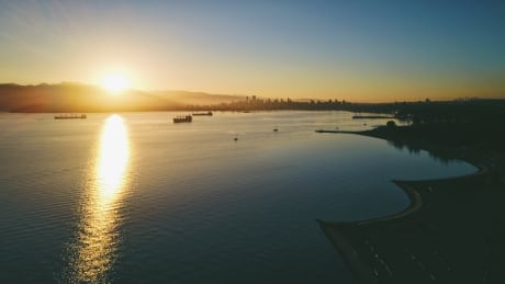 STOCK SUNRISE SPANISH BANKS VANCOUVER BC UBC SUN SUNSHINE