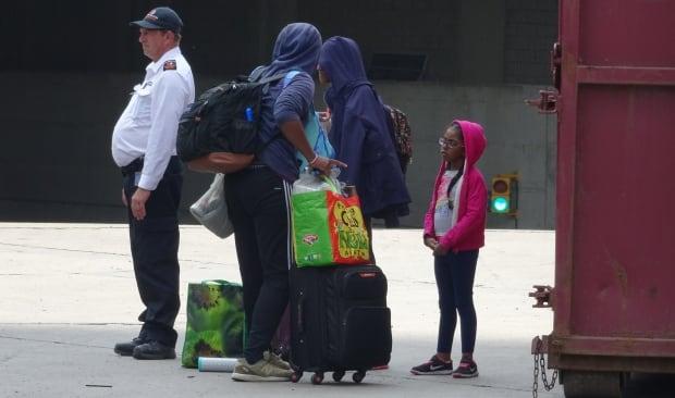 Asylum seekers arrive at Olympic Stadium Aug. 3, 2017