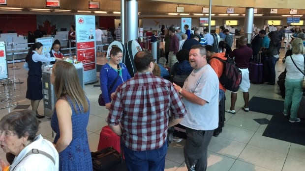 People had to be manually checked in at the Air Canada counter at St. John's International Airport, amid a service outage Friday afternoon.