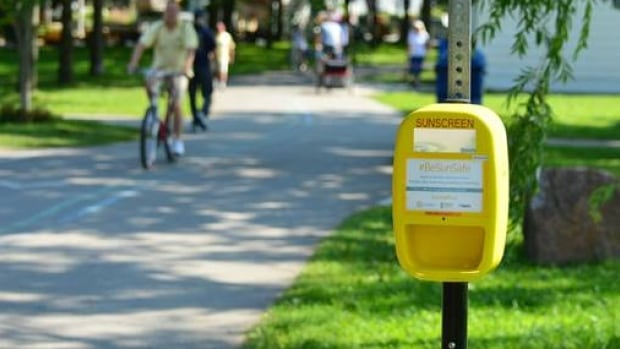 Sunscreen dispensers are paired with notes on when to apply sunscreen. The David Cornfield Melanoma Fund and the Douglas Wright Foundation hope they'll soon be able to expand the program to more city parks.
