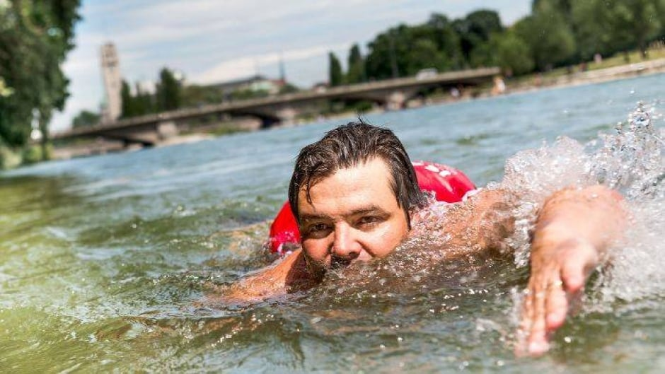 Benjamin David swims two kilometres to work every day along the Isar River in Munich.