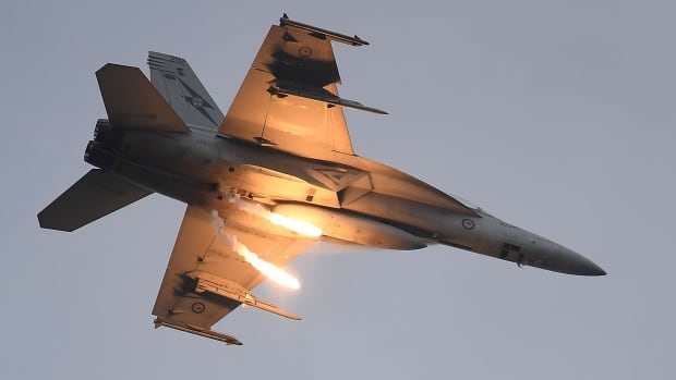 A Royal Australian Air Force F-18 Super Hornet drops two flares at an October 2016 airshow. Canada has opened negotiations for the sole-source purchase of 18 of the advanced jet fighters.