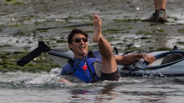 Prime Minister Justin Trudeau falls into the water while trying to get into a kayak at Sidney Spit in the Gulf Islands National Park Reserve, near of Sidney, B.C.