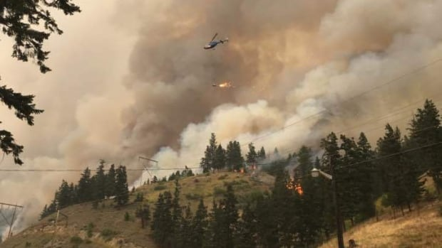 A helicopter sets a control burn in the Hart Ridge area near Highway 97, south of Clinton.