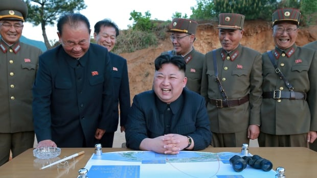 North Korean leader Kim Jong-un, in an undated photo released in May, reacts during the long-range strategic ballistic rocket Hwasong-12 (Mars-12) test launch.