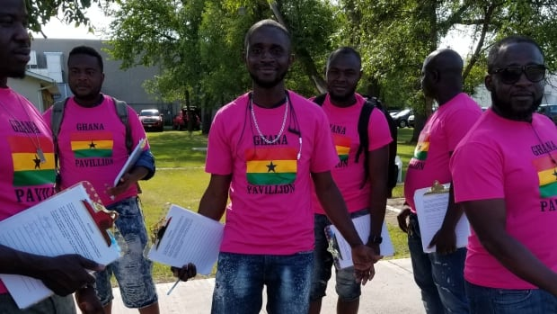 "Sulemana Abdulai and a group of protesters wearing ""Ghana Pavillion"" shirts collect signatures outside a Folklorama pavilion in Winnipeg."