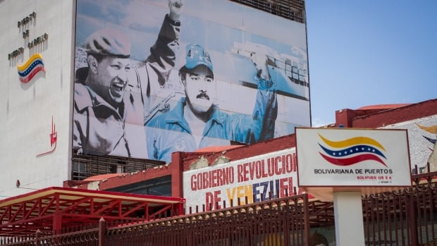 A mural to former Venezuelan president Hugo Chavez and current President Nicolas Maduro adorns the wall of offices of the port of Puerto Cabello. Maduro's ruling party supports Chavism, a brand of socialism named for the late president.