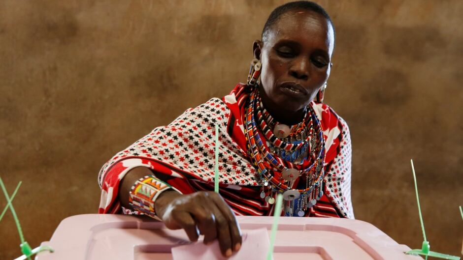 A Maasai tribeswoman votes during the presidential election in Kisamis, Kenya, Aug. 8, 2017.  Around 19 million people are registered to vote in the country.