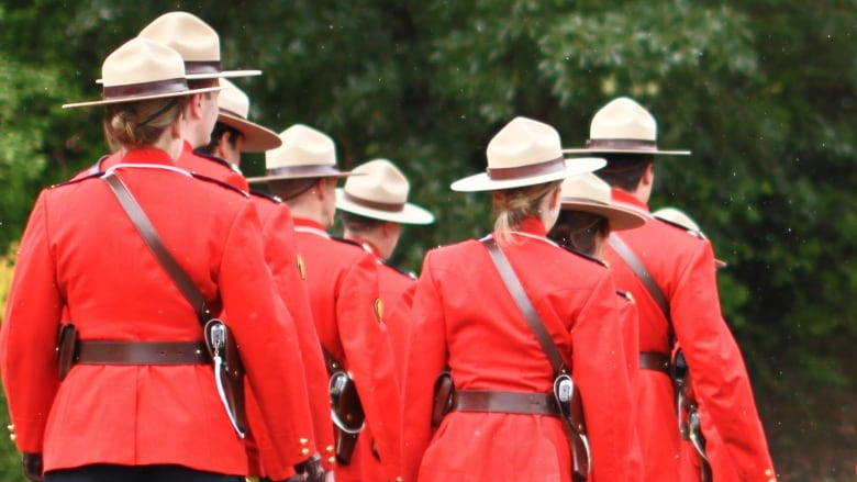 RCMP officers with no faces shown