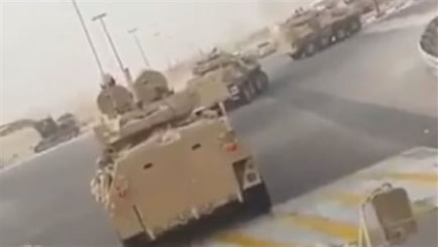A still from a video obtained by Radio Canada International shows a column of light armoured vehicles like those produced by General Dynamics Land Systems Canada being deployed by Saudi forces in a crackdown against Shia militants in the kingdom's Eastern Province. RCI could not independently verify the authenticity of the video.
