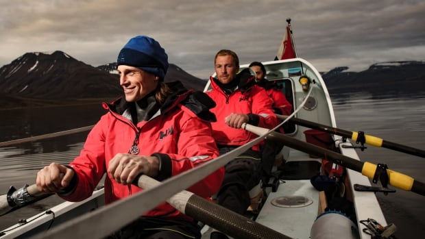 Fiann Paul, front, Alex Gregory and Carlo Facchino are rowing across the Arctic Ocean north to south, breaking records for speed and for how far north they've rowed.