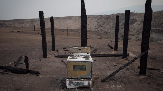 A stove sits among the remains of a structure that burned in a wildfire on the Ashcroft First Nation near Ashcroft, B.C.