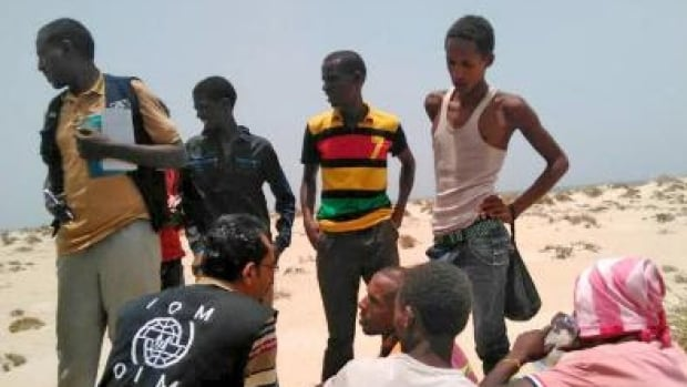 International Organization for Migration staff assist Somali and Ethiopian migrants who were forced into the sea by smugglers.