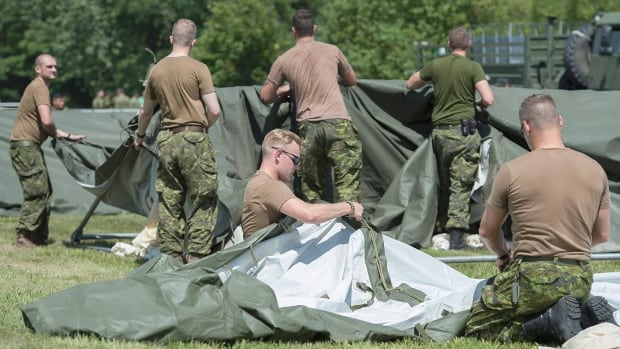 Members of the Canadian armed forces erect tents to house asylum seekers at the Canada-United States border in Lacolle, Que.