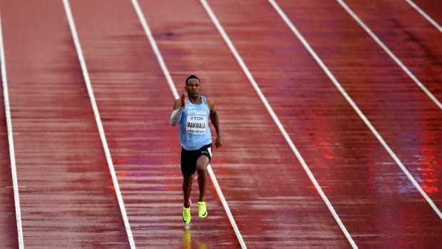 Botswana's Isaac Makwala runs a men's 200-metre individual time trial after previously being barred from the competition because it was believed he was ill from norovirus.